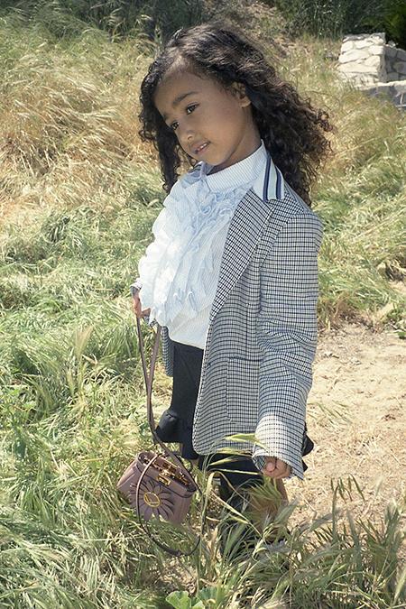 57172 Стиль звездных детей: повзрослевшая дочь Ким Кардашьян и Канье Уэста - Норт